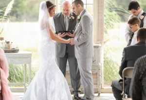 Austin officiant offering blessing over marriage
