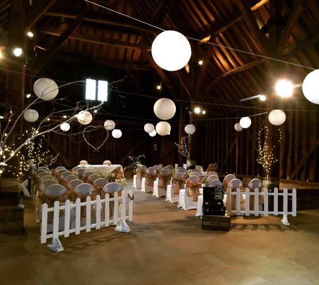 Barn wedding with fairy lights and chair ties rustic barn wedding inspiration