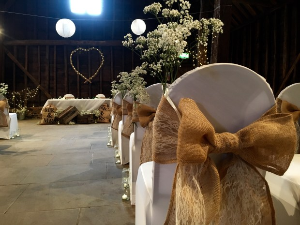 Lace and hessian chair covers rustic barn wedding inspiration