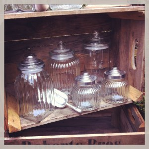 sweetie jars and scoop in wooden crate