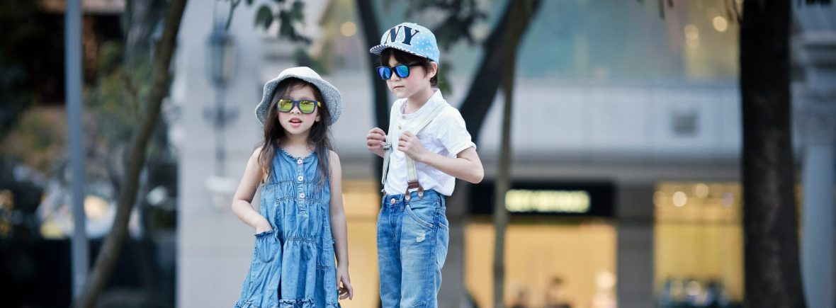 Boy and girl wearing IE9011 Revo mirror sunglasses