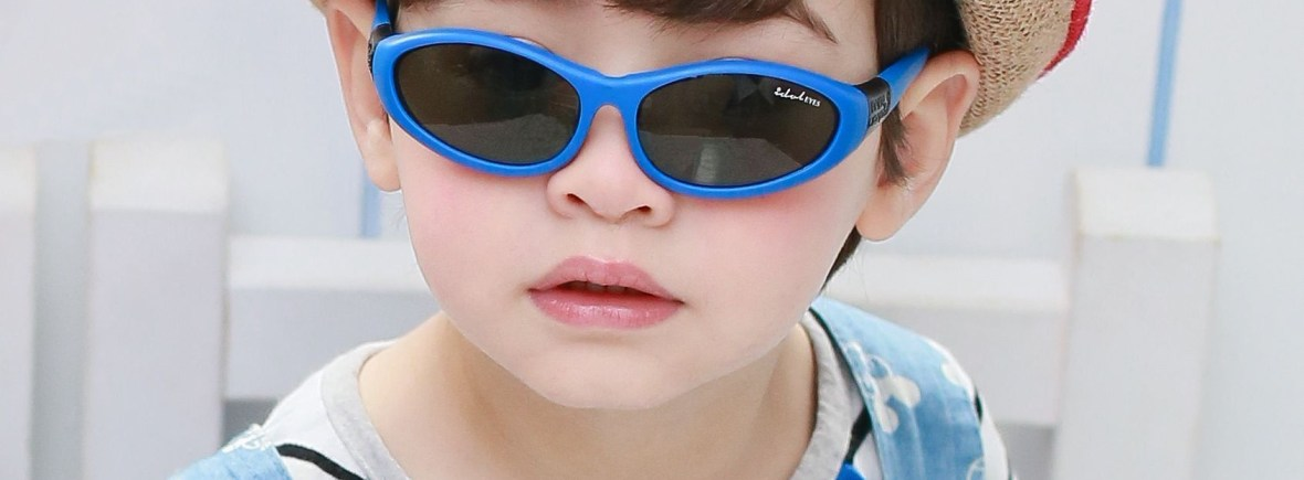 IE88C - Young boy wearing Baby Wrapz 2, convertible baby sunglasses in a blue frame