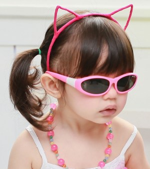 Baby Wrapz 2 - Young girl wearing Baby Wrapz 2 convertible baby sunglasses, pink frame
