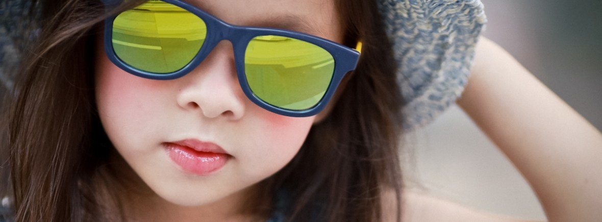 Girl wearing IE9011 Navy/Yellow frame with Revo mirror lens