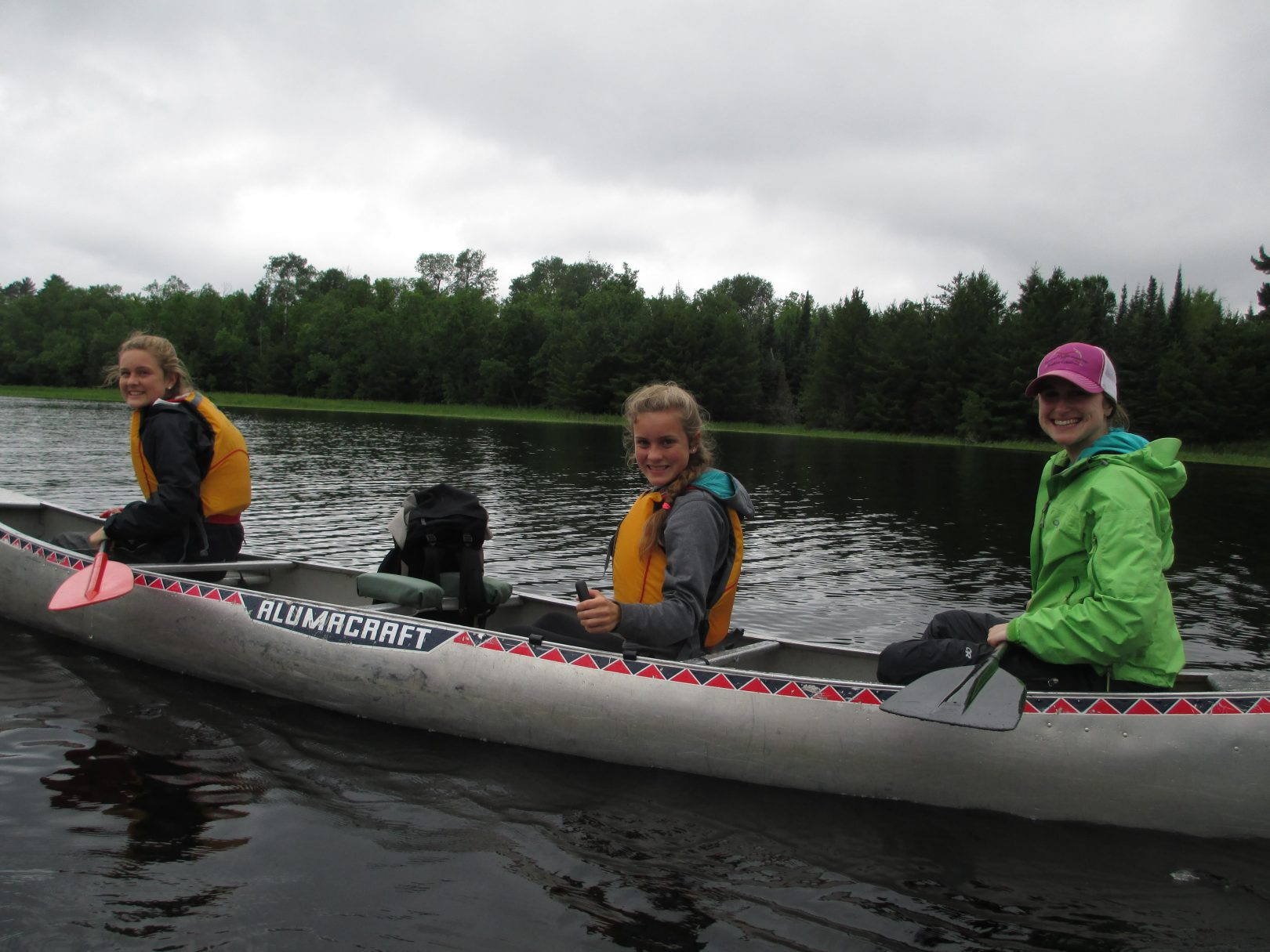 3 young recruits canoeing on a wide open lake