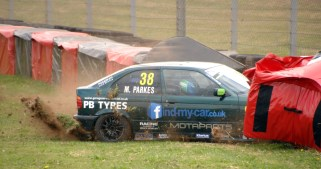 Nankang Tyres BMW Compact Cup competitor Matthew Parks in his E36 Compact 318TI makes contact with the tyre wall at Quarry Corner on Sunday. https://idrismartin.wordpress.com/