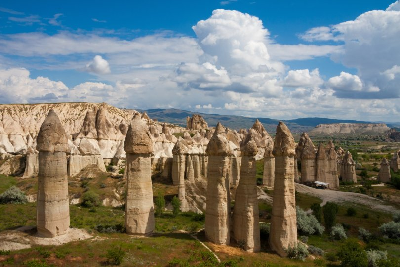 """The famous fairy chimneys of Cappadocia stand tall in the sunlight in the Göreme village at a location known as the """"Love Valley,"""" Nevşehir, Turkey. (Shutterstock Photo)"""