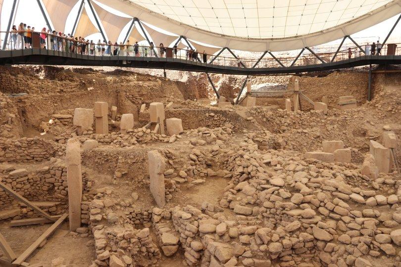 Visitors examine T-shaped obelisks in Göbeklitepe, Şanlıurfa, southeastern Turkey, July 5, 2021. (AA Photo)