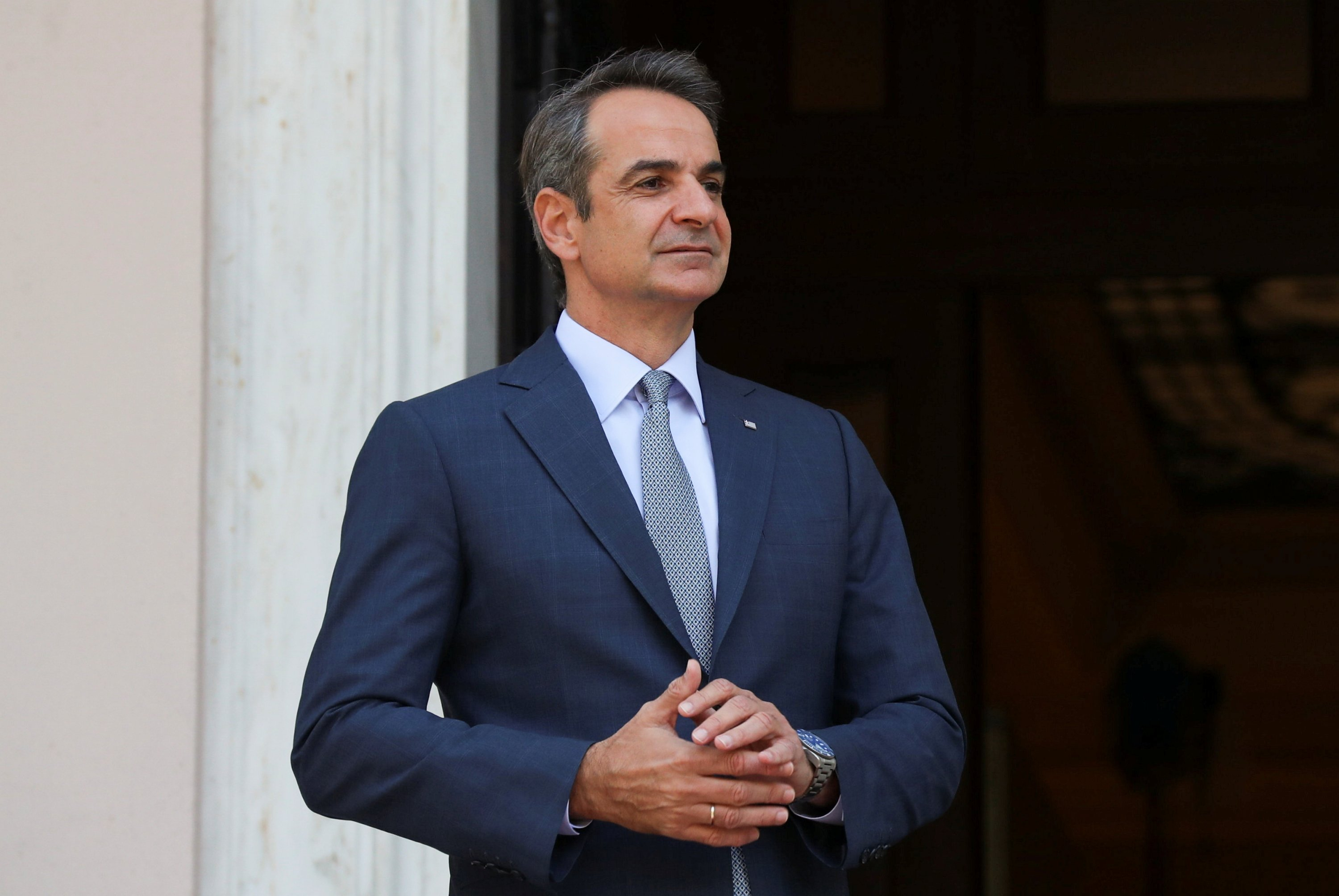 Greek Prime Minister Kyriakos Mitsotakis looks on before greeting Slovakian Prime Minister Eduard Heger at the Maximos Mansion in Athens, Greece, Sept. 30, 2021. (Reuters Photo)