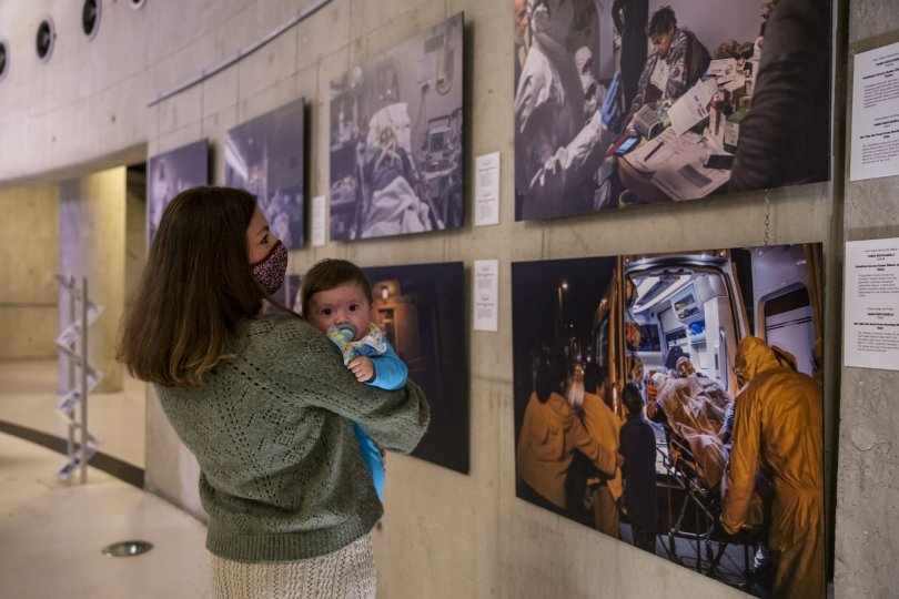 A visitor with her baby examines some photos from the exhibition at CerModern Arts Center, Ankara, Turkey, Oct. 11, 2021. (AA Photo)
