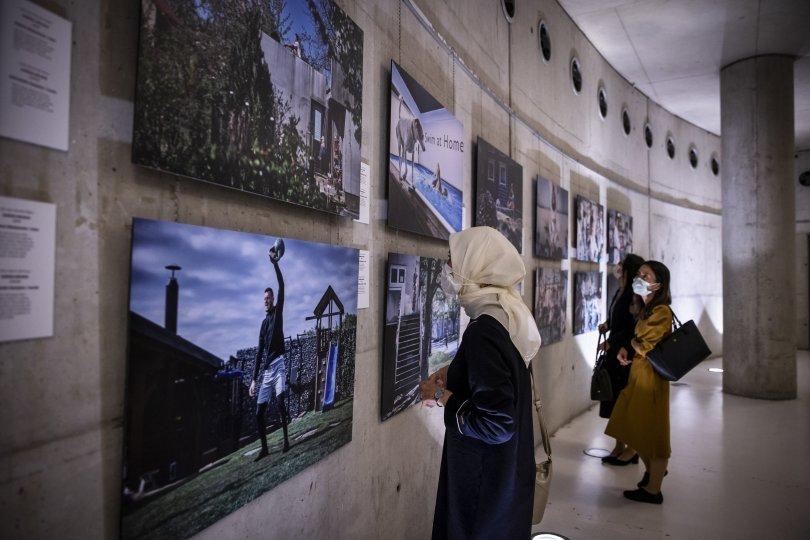 Visitors examine some photos from the exhibition at CerModern Arts Center, Ankara, Turkey, Oct. 11, 2021. (AA Photo)