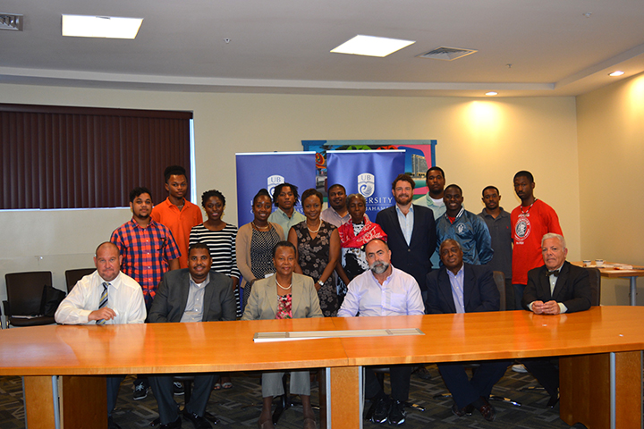 The Residency Harbour Island MOU with the School of Architecture Group photo: First row, from left): Chair of SOSC, Dr. Christopher Curry; UB Dean Carlton Watson, Dean of Pure and Applied Science; UB Provost Dr. Linda Davis; Dr. Rodolphe el-Khoury, Dean & Professor of Architecture and Urbanism, University of Miami; Dr. Keith Tinker, Director Antiquities, Monuments, Museum Corporation and UB Teaching Scholar; Trafilo Victoria, Associate Professor University of Miami, School of Architecture.(Second row, from left): UB students along with Ms. Dean, AMMC employee and former UB A.A. graduate in architecture, UB Valaria Pintard-Flax, Assistant Professor of Architecture; Alicia Oxley, Special Architectural Consultant, AMMC and Rick Lopez, Associate Professor University of Miami, School of Architecture. (Third row, centre): Philip Armbrister, UB Chair Mathematics, Physics & Technology.