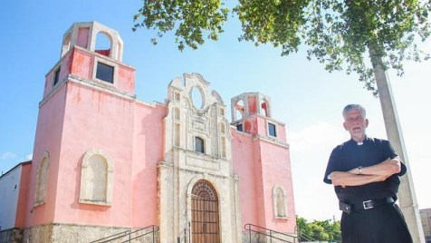 ather José Luis Menéndez, at Nuestra Señora de la Merced Chapel at Corpus Christi Catholic Church, in Allapattah, Miami