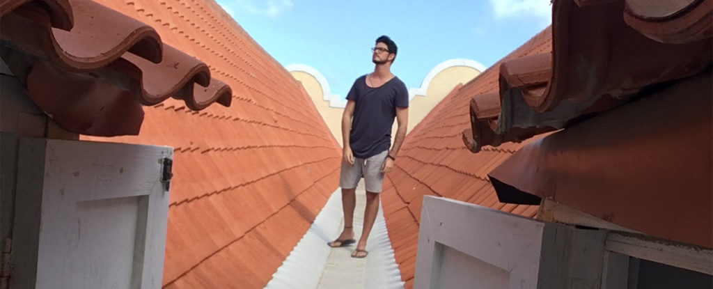 University of Miami student Hector Valdivia Arrieta walks the rooftop of the triple vaulted ceiling of the Mikvé Israel Emanuel Synagogue in Willemstad, Curaçao