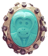 """CHICAGO - Bank of America exec Mario Elizondo ripped of Neiman Marcus on North Michigan Avenue for over $2,000 in just the single transaction for this one of a kind Amedeo Monkey Business topaz and red saphirre ring. The ring was gift-wrapped for an """"anniversary"""" gift to Jorge Cadenas while staying at the Chicago Waldorf Astoria Hotel the first week in April 2016. The ring is just the one of thousands of fraudulent transactions made using the bogus Bank of America debit cards. 2016 All rights reserved IDTheftReports2020.com"""