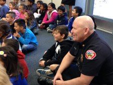 iecn photos/yazmin alvarez Joe Powell, Rialto fire EMS, sits with students during the annual water safety program