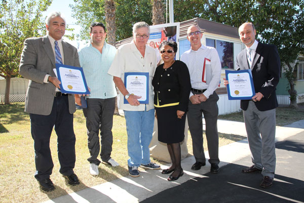 Photo Courtesy/SoCalGas (Center) Assemblymember Cheryl Brown, California State Assembly, District 47, presents certificates of recognition to Steve McLemore and his son Byron McLemore, SoCalGas executives David Buczkowski and Joe Velasquez and Sunil Shori, California Public Utilities Commission, Safety and Enforcement Division, Nov. 6, 2015. (left) Shori, Steve McLemore and his son, Byron, Brown, Buczkowski, and Velasquez