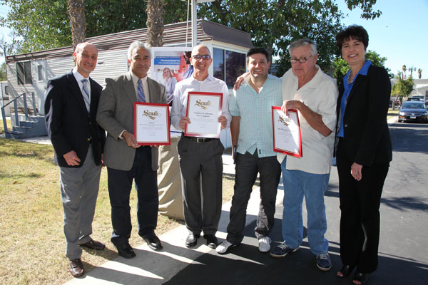 Photo Courtesy/SoCalGas (Right) Sen. Connie M. Leyva, California State Senate, District 20, presents certificates of recognition to Steve McLemore and his son Byron McLemore, owners of Mt. Slover Trailer Village in Colton, and David Buczkowski, senior director of major projects, SoCalGas, Sunil Shori, California Public Utilities Commission, Safety and Enforcement Division and Joe Velasquez, MHP Utility Upgrade Program director, during a ribbon-cutting ceremony in Colton, Nov. 6, 2015.