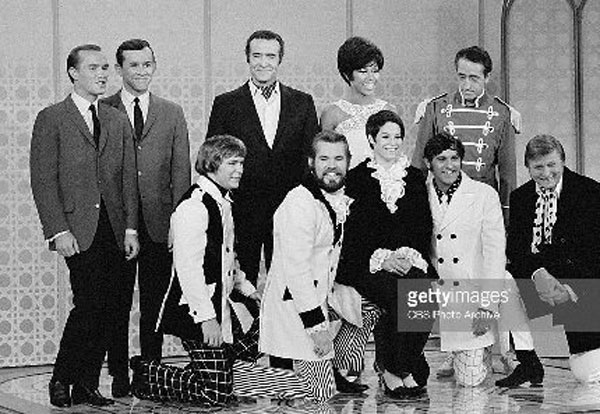 Photo Courtesy/CBS Thelma Camacho in 1967 with First Edition on Smothers Brothers TV show. Back row (Left) Tom and Dick Smothers; Ricardo Montalbon; Diahann Carroll; Pat Paulson. Front Left: Terry Williams, Kenny Rogers; Camacho; Mike Settle and Mickey Jones.