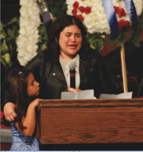 Photo/Anthony Victoria Illisa Gallegos, 20, speaking about her brother Dominick Gallegos during his funeral service on April 21. By her side is her 7-year-old sister Gabriela.
