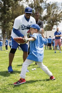 courtesy photo/rialto network  Young baseball fans took to the mounds with Dodger Legends during the grand reopening of Bud Bender Park May 14..