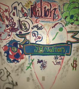 """Photo/Anthony Victoria: The pstatement, """"YB Nation"""" scrawled on the walls throughout an apartment that was leased to a Branden Ross, according to court documents."""