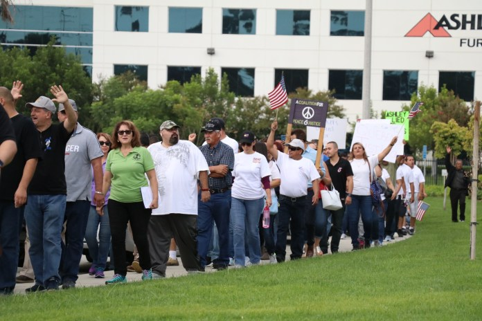 photo anthony victoria hundreds of people protesting outside ashley furniture offices in colton on labor day