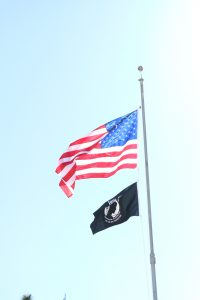 Photo/Anthony Victoria: The American and POW/MIA flags flying over Downtown San Bernardino.