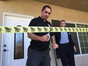 iecn photo/yazmin alvarez Marine Staff Sgt. Hans Blum is given the keys to his new home during a ceremonial welcome home ribbon cutting Sept. 25.