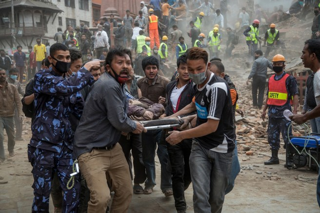 Rescue work following 7.8 Richter scale earthquake. Image by Omar Havana via https://www.theatlantic.com/photo/2015/04/nepal-after-the-earthquake/391481/