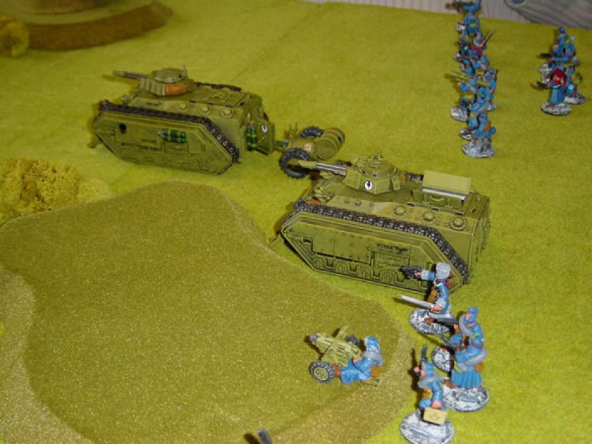 Chimera and Hellhound move forward supported by Imperial Guard infantry.