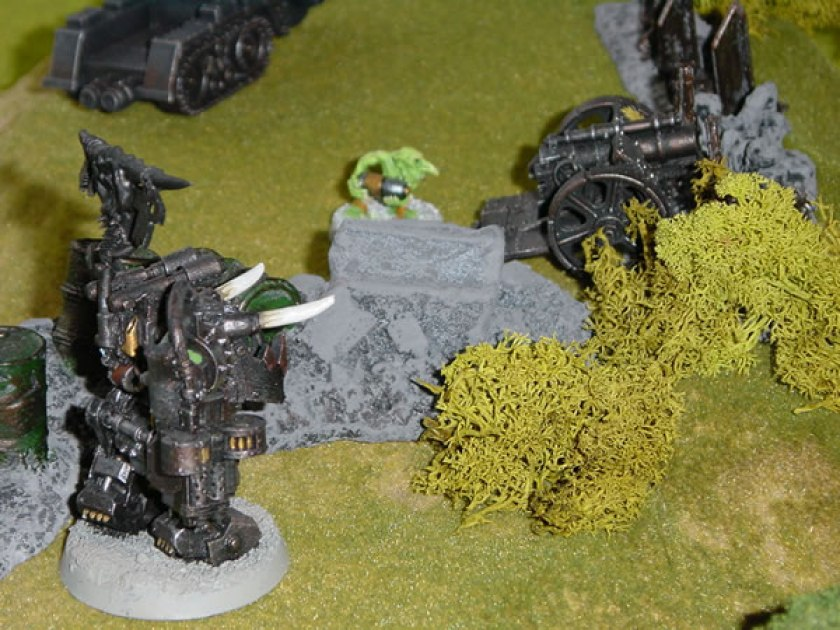 Ork Warboss in Mega-Armour from Felix's collection moving on the grass.