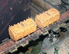 Munitorum Armoured Containers which are being transported by rail