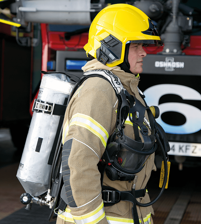 Firefighter Roger Davies fully kitted out in the new PPE and Interspiro Breathing Apparatus.