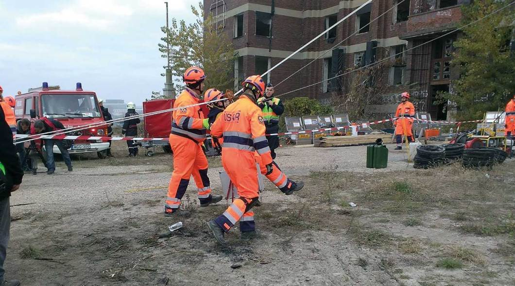 Central voluntary rescue organisation is using rope technique. Annual exercise is holding on formal industrial area at Budapest in 2015 winter.
