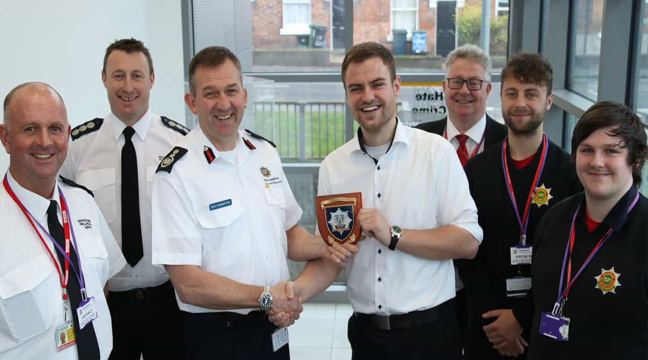 Shropshire's Chief Fire Officer Rod Hammerton (centre) presents a plaque to Danish intern Andreas Sorgensen with Warwickshire Watch Commander Paul Whittaker and Station Commander John Wilson (both left) and Staffordshire's Learning and Development team Tim Wareham, Jack Burton and Tom Griffiths.