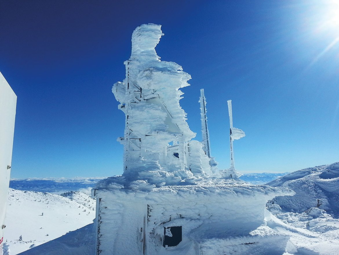 Remote mountaintop site with Axis camera installation for remote monitoring.