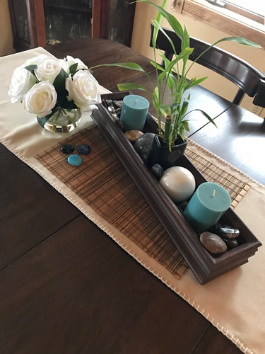 DIY Tip! Add emphasis to a room. Decorative centerpiece using a placemat to add a layer of interest. #homedecor #DIY