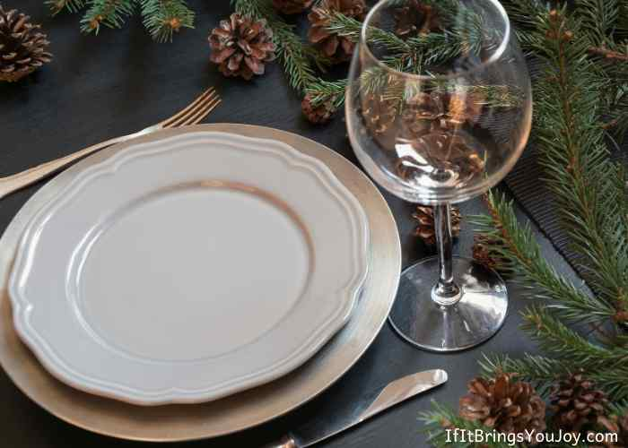 Table place setting with pine cones and boughs