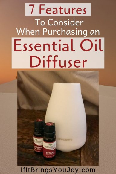 Essential oil diffuser and two bottles of essential oils