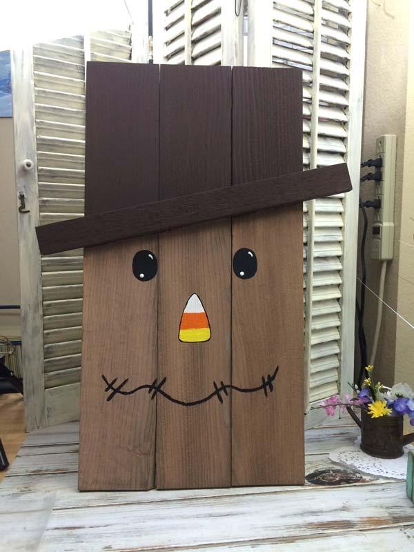 Scarecrow decor made from cedar pickets