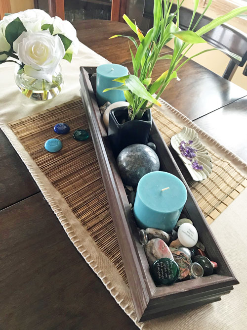 Table centerpiece filled with items that attract positive energy in the home.