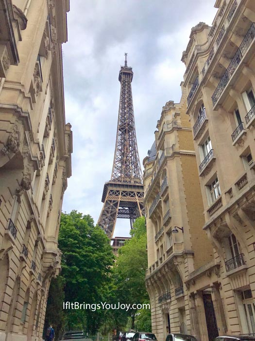 Eiffel tower peeking through the buildings