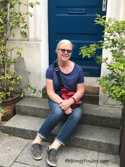 Posing on a pretty doorstep in Paris, France.