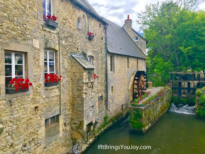 Water wheel and stream in Bayeux, France.