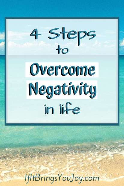 Overcome negativity message with peaceful beach background