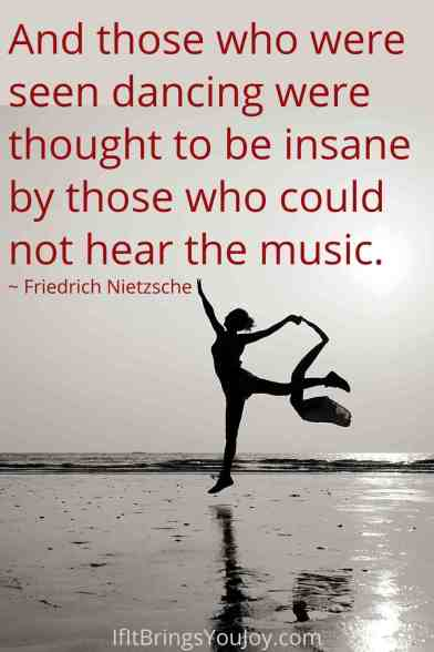 Woman dance on the beach with a quote by Friedrich Nietzsche.
