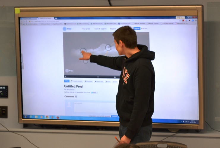 student interacting with touchscreen in education building room 42