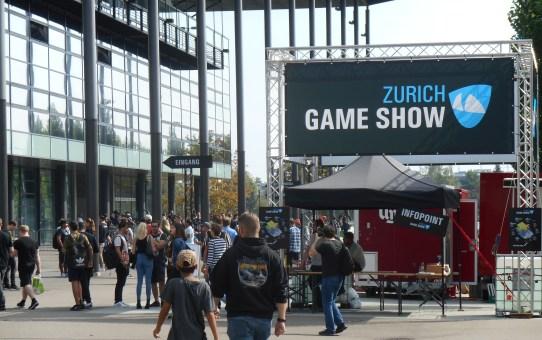 Zürich Game Show mit Killergames. Nebenan: Kriegsflüchtlinge und Rüstungsproduktion