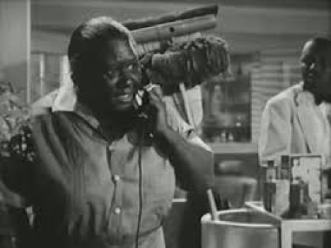 Etta McDaniel, sister of renowned character actress Hattie. She was in 61 movies from 1933 to 1946, mostly in maid or mammy roles. Her first film role was as a native in King Kong, and she appeared in such films as Stella Dallas and Son of Dracula. Pictured here in False Faces (1943), a run of the mill Republic Studios murder mystery, with a few extra twists to the script courtesy of writer Curt Siodmak. Paired with slow and querulous Nick (Nicodemus) Stewart as an apartment building maid